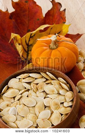Vertical Shot Of Toasted Pumpkin Seeds And Autumn Colors