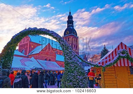 Unidentified Group Of People Enjoy Christmas Market