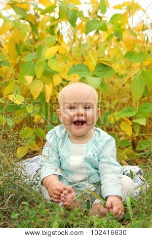 Beautiful Baby Outside In Nature In Autumn