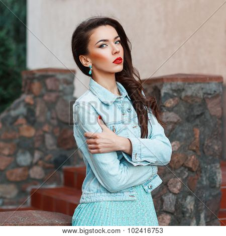 Fashion Portrait Of A Beautiful Stylish Woman With Red Lips In A Denim Jacket