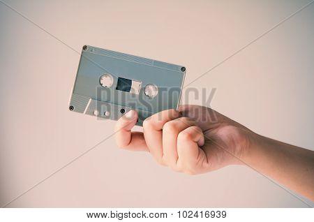 Hand Offer Old Retro Cassette Tape.