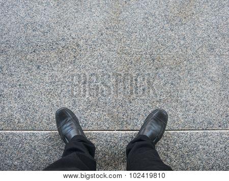 Business Man Look Down To Floor.
