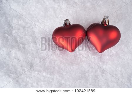 Two Red Hearts On Snow