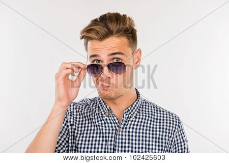 Man Grimacing And Down On His Nose Glasses