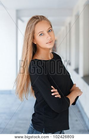 Beautiful Girl With Blue Eyes In Black T-shirt On The Background Leaving Prospects