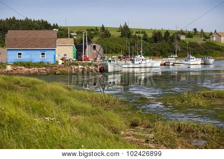 Wharf and fishing boats in French River, Prince Edward Island.
