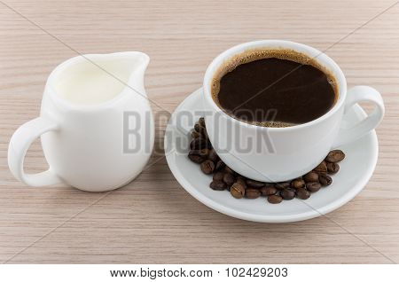 Cup Of Hot Coffee, Coffee Beans And Jug Milk