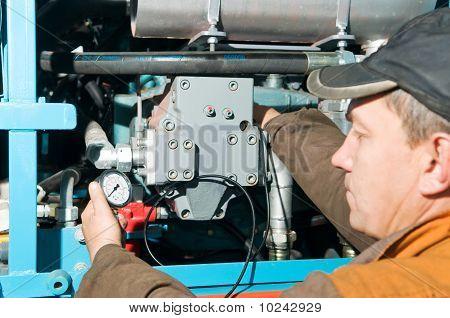 Repairman Using Manometer