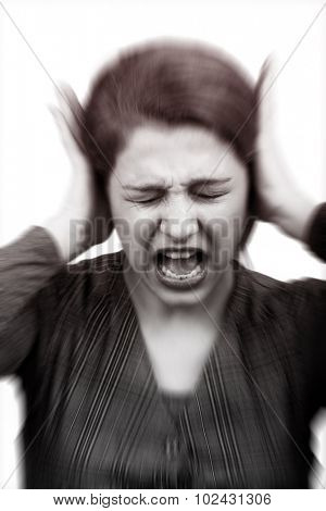 Noise stress concept - stressed woman covering ears
