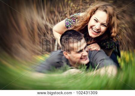 Happy young couple having fun outdoors