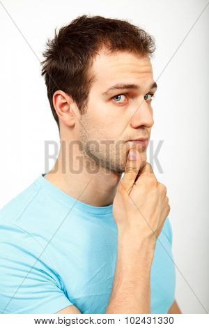 Young man wondering isolated on white