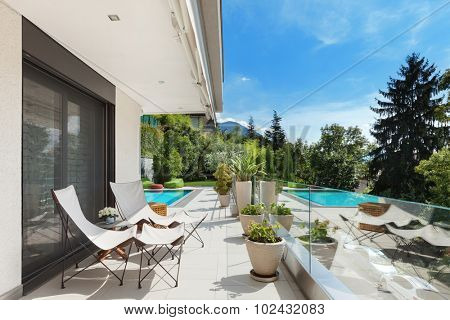 Modern house, beautiful terrace with swimming pool