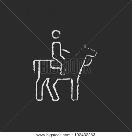Horse riding hand drawn in chalk on a blackboard vector white icon isolated on a black background.