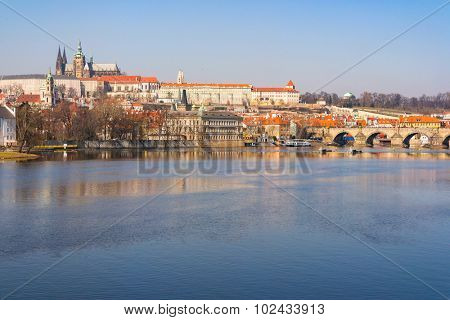 sunset view of Prague castle and Charles bridge, Czech Republic