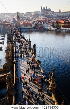 sunset view of Prague castle and Charles bridge over Vltava river, Czech Republic