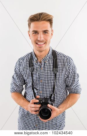 Photographer Holding A Camera