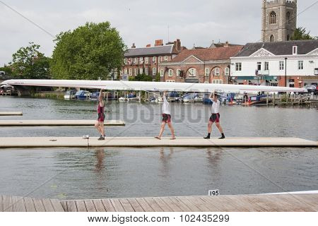 HENLEY, ENGLAND. 01-07-2010. A crew carry their boat off the river on day 2 of the Henley Royal Regatta 2010 held on the River Thames.