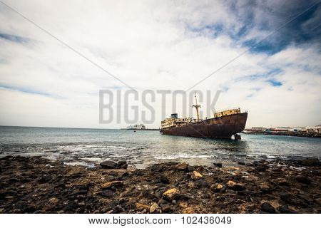 old broken ship agrounded near Lanzarote seashore, Canary Islands, Spain