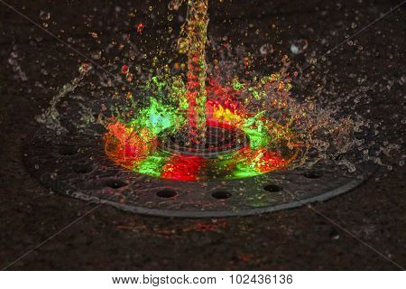 LED Backlight jet fountain at night