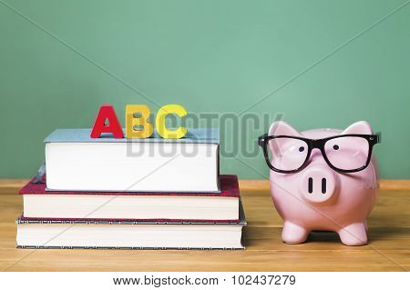School Theme With Abcs And Pink Piggy Bank With Chalkboard In The Background