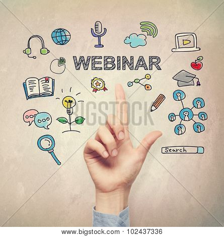 Hand Pointing To Webinar Concept
