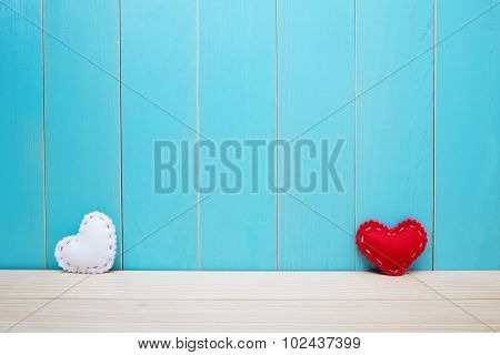 Hand Crafted Red And White Felt Hearts On Blue Background