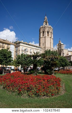 VALENCIA, SPAIN - SEPTEMBER 19, 2015: Plaza de la Reina and Micalet tower in Valencia. The Micalet tower, 51 meters tall, is known as the belfry of the Valencia Cathedral.