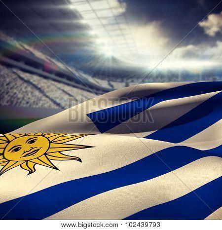 Waving Uruguayan flag against rugby stadium