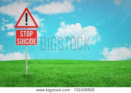 stop suicide against green field under blue sky