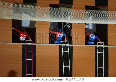ST. PETERSBURG, RUSSIA - SEPTEMBER 7, 2015: Semi-final female race in the rise of a hook ladder during XI World Championship in Fire and Rescue Sport. First World Championship was held in 2002