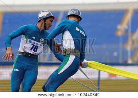 ST. PETERSBURG, RUSSIA - SEPTEMBER 9, 2015: Team Uzbekistan compete in combat deployment during XI World Championship in Fire and Rescue Sport. First World Championship was held in 2002