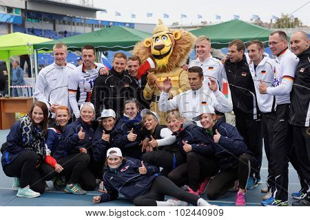 ST. PETERSBURG, RUSSIA - SEPTEMBER 9, 2015: Team Germany make photo with the mascot after last competitions of XI World Championship in Fire and Rescue Sport. First World Championship was held in 2002