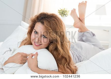 Beautiful Smiling Woman Laying In Her Bed In The Morning