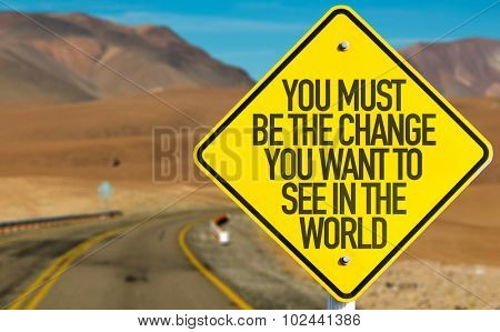 You Must Be The Change You Want To See In The World sign on desert road