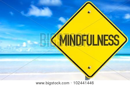 Mindfulness sign with beach background