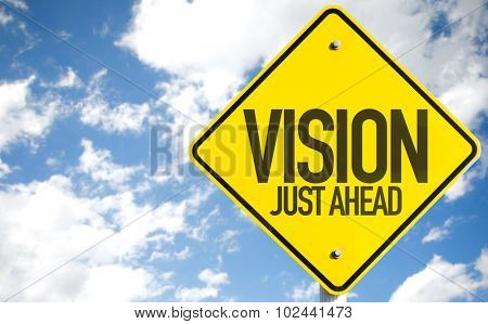 Vision Just Ahead sign with sky background