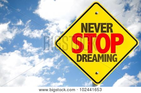 Never Stop Dreaming sign with sky background