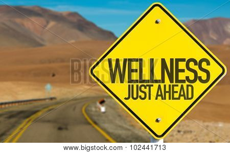 Wellness Just Ahead sign on desert road