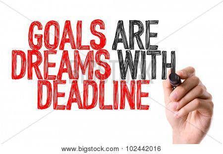 Hand with marker writing: Goals Are Dreams With Deadline