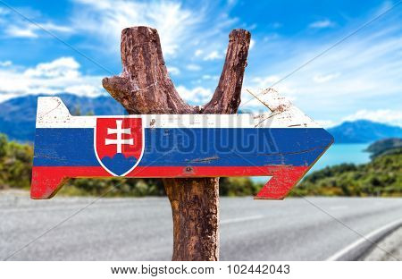 Slovakia Flag wooden sign with road background