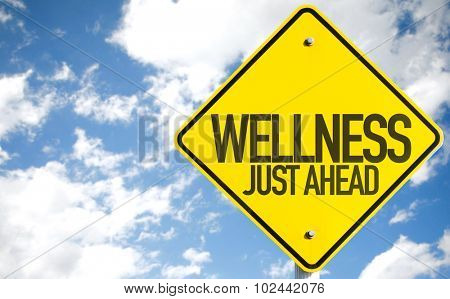 Wellness Just Ahead sign with sky background