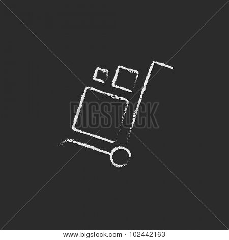 Shopping handling trolley hand drawn in chalk on a blackboard vector white icon isolated on a black background.