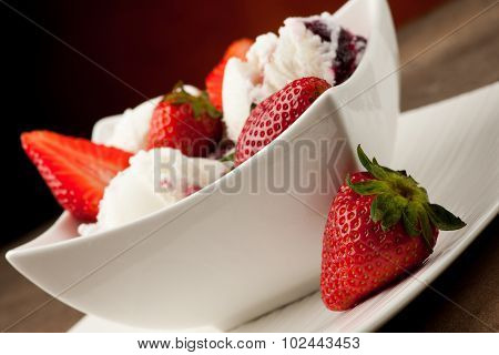 Strawberry Icecream In A White Bowl  With Strawberries