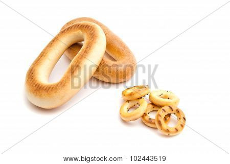 Heap Of Different Bagels On White