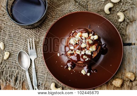 Chocolate Pancake With Bananas, Nuts And Chocolate Sauce