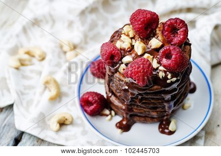 Chocolate Pancake With Bananas, Raspberies, Nuts And Chocolate Sauce
