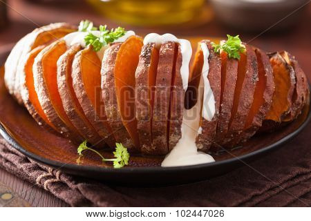 Baked hasselback potatoes with sour cream
