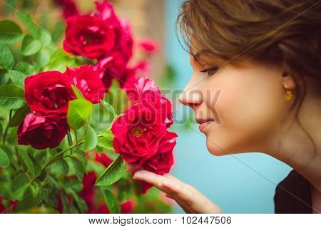 Beautiful Woman Smelling Red Roses