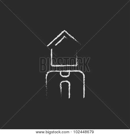 Real estate agent hand drawn in chalk on a blackboard vector white icon isolated on a black background.
