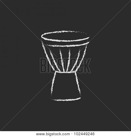 Timpani hand drawn in chalk on a blackboard vector white icon isolated on a black background.